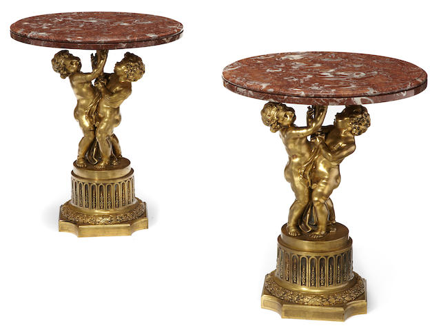 A pair of Louis XVI style gilt bronze and marble figural tables <BR />bases late 19th century