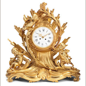 A Louis XV style gilt bronze figural mantel clock. by Henri Picard and Raingo Freres . fourth quarter 19th century
