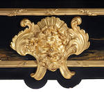 A Louis XV style gilt bronze and Chinoiserie lacquer mounted ebonized bureau plat <BR />late 19th/early 20th century