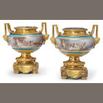 A pair of Sèvres style porcelain gilt bronze mounted two handled urns <BR />fourth quarter 19th century