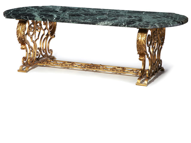 A Renaissance style gilt iron and verde antico marble dining table   20th century
