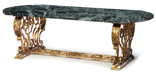 A French Baroque style gilt iron and Vert Maurin marble dining table  20th century