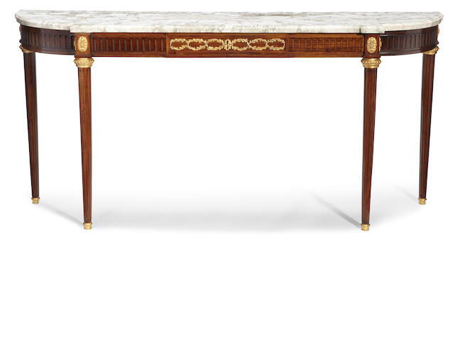 A Louis XVI style gilt bronze mounted mahogany and marble console desserte   late 19th/early 20th century