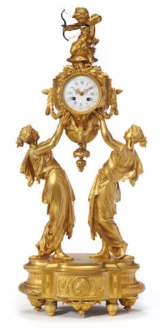 A Louis XVI style gilt bronze figural mantel clock<BR />Charpentier & Cie  late 19th century