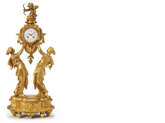 A Louis XVI style gilt bronze figural mantel clock  late 19th century