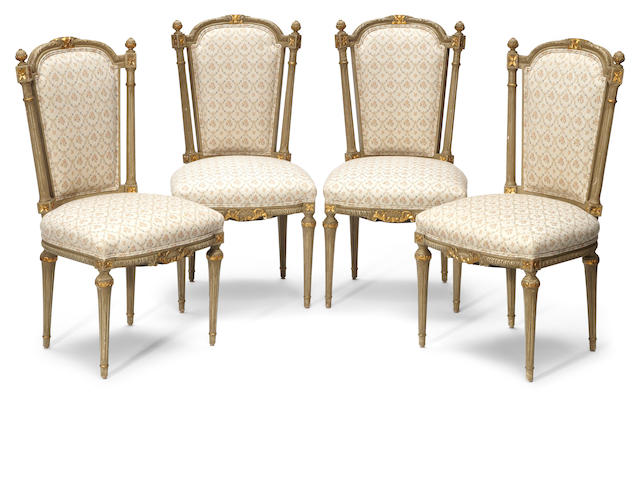 A set of eight Louis XVI style parcel gilt and painted chairs