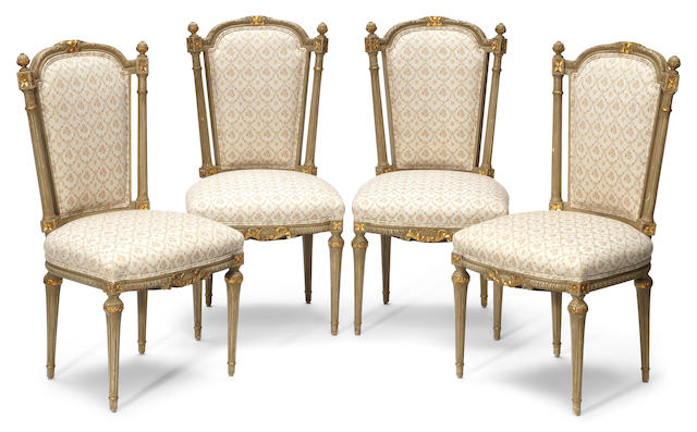 A set of eight Louis XVI style parcel gilt and paint decorated chairs first half 20th century
