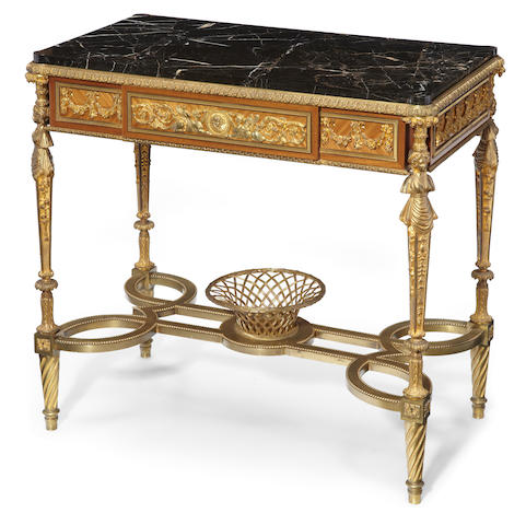 A Louis XVI style gilt bronze mahogany and kingwood center table <BR/>after a model by Adam Weisweiler<BR/>late 19th century