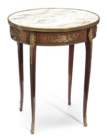 A Louis XV style gilt bronze and marble mounted mahogany guèridon <BR />early 20th century