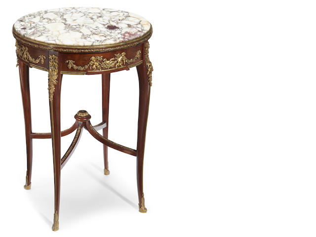 A Louis XV/XVI Transitional style gilt bronze and marble mounted guèridon <BR />early 20th century<BR />possibly François Linke