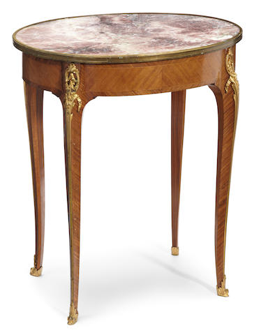 A Louis XV/XVI Transitional style gilt bronze and marble mounted kingwood and satinwood guéridon <BR />late 19th/early 20th century