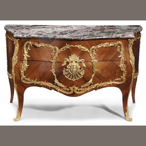 A Louis XV style gilt bronze mounted rosewood commode . third quarter 19th century