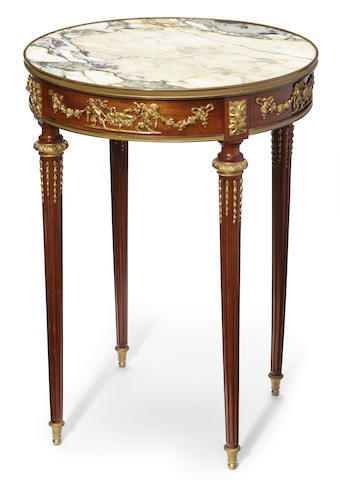 A Louis XVI style gilt bronze and marble mounted mahogany guèridon <BR />early 20th century