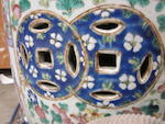 A pair of famille rose enameled porcelain garden stools Late 19th century