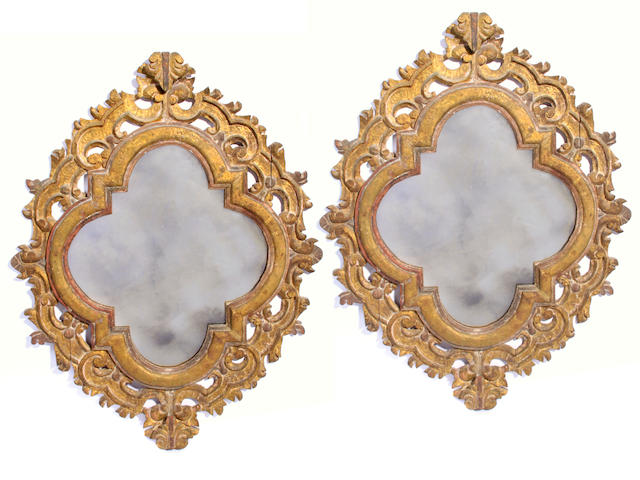 A pair of Continental Baroque style parcel gilt paint decorated mirrors