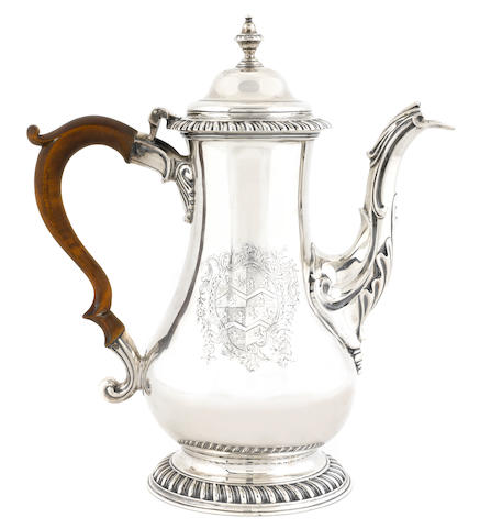 A George III  sterling silver  coffee pot by John Denwall, London, 1774