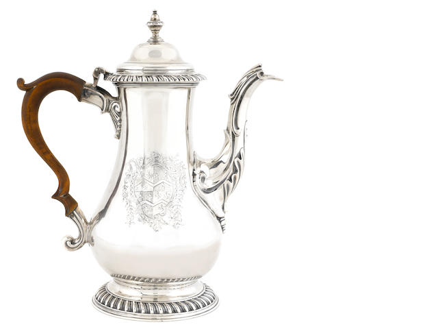 "A George III sterling silver coffee pot, maker's mark ""I.D"", London, 1774"