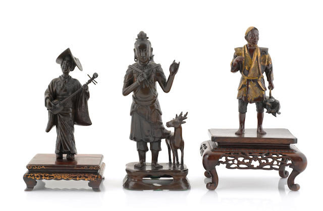 A group of three Japanese bronze figures