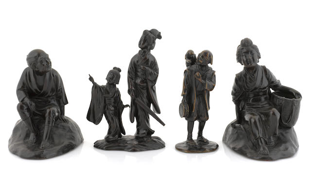 A group of four Japanese bronze figures