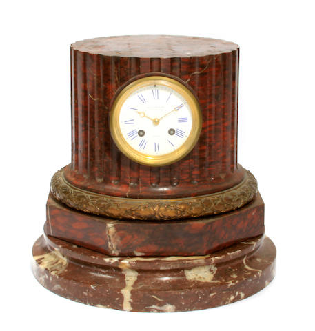 A French rouge marble mantel clock