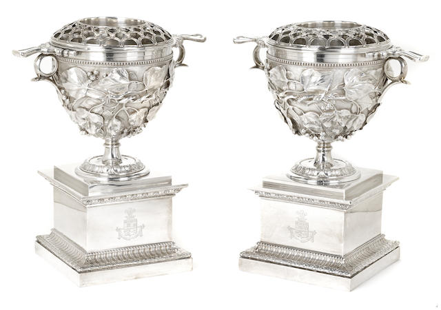 A pair of Victorian  electroplated  foliate-decorated urn-form wine coolers on stands by Elkington, Mason & Co., Birmingham,  mid-19th century