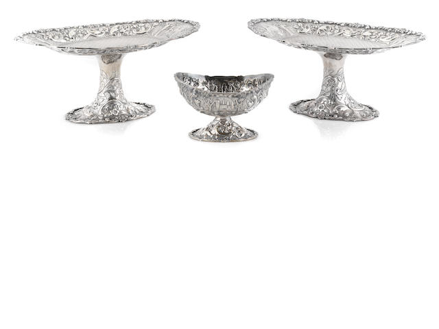 A Loring Andrews sterling silver Castle pattern three piece table suite, a pair of oval compotes and an oval footed bowl
