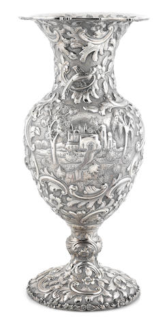 An American  sterling silver  repousse-decorated baluster vase retailed by the Loring Andrews Company, Cinncinatti, OH,  late 19th / early 20th century