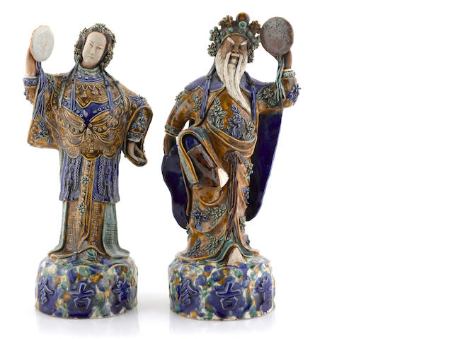 A pair of Sancai glazed statues