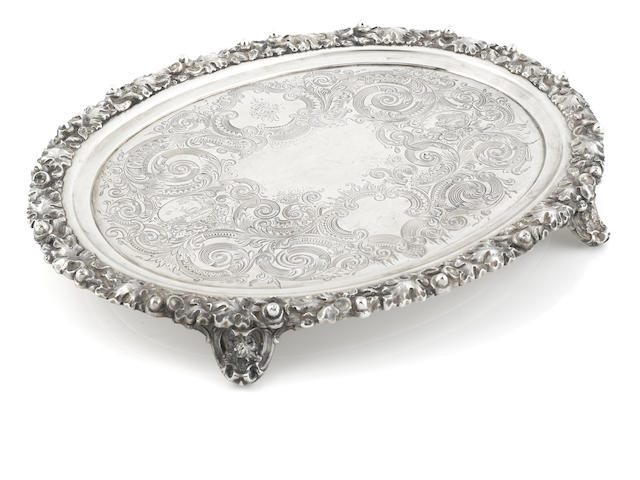 An American  coin silver  engraved, applied and chased foliate-decorated oval footed salver retailed by J.E. Caldwell & Co., Philadelphia,  mid-19th century