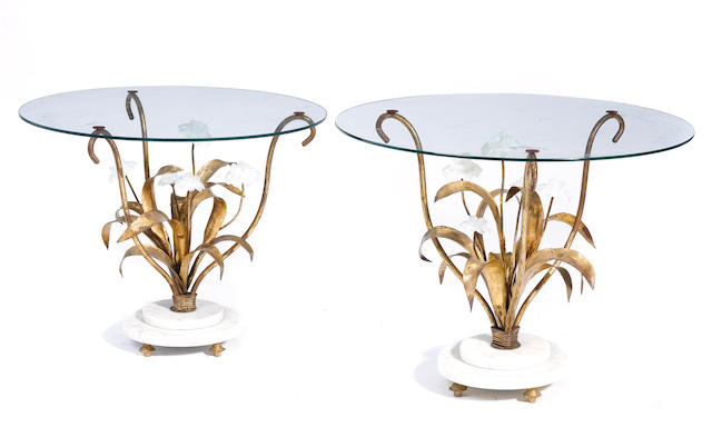 A pair of Art Deco style gilt metal and glass side tables