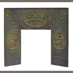 A Louis XVI style cast iron fire surround