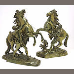 A pair of bronze Marley horses after a model by Coustou