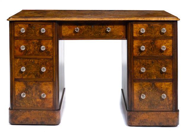 A Victorian burl walnut pedestal desk