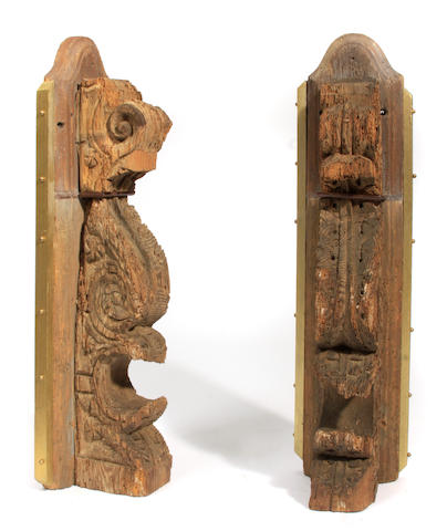 A pair of Continental Baroque oak corbels