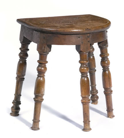 A Louis XIV style carved walnut stool