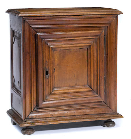 An Italian Baroque style fruitwood side cabinet