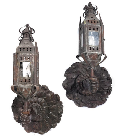 A pair of Baroque style carved oak and tin wall lanterns