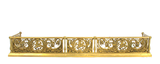 A French gilt metal mounted firescreen and brass fire fender