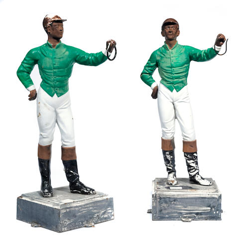 A pair of paint decorated cast iron lawn jockeys