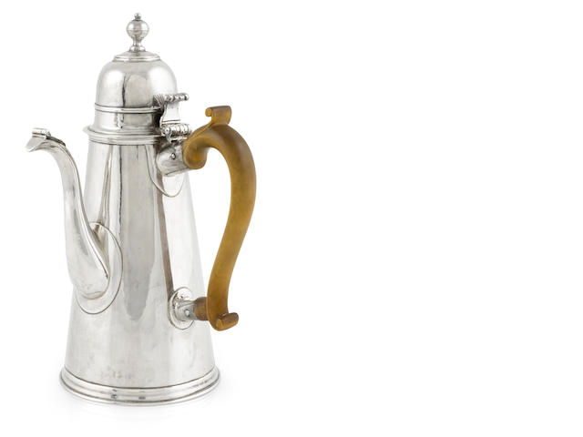A Queen Anne Britannia standard silver coffee pot, possibly John Gibbons, London, 1706