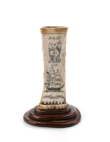 Scrimshaw candlestick with relief carved rose on one side and crossed American flags and ship with border on other