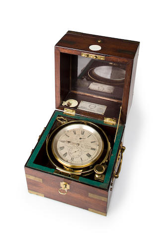 A two-day marine chronometer<BR /> circa 1860 7-1/4 x 7 x 7 in. (18.4 x 17.8 x 17.8 cm.) box.