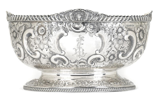 A Victorian  sterling silver  floral and foliate repousse decorated oval center bowl by Atkin Brothers, Sheffield,  1895