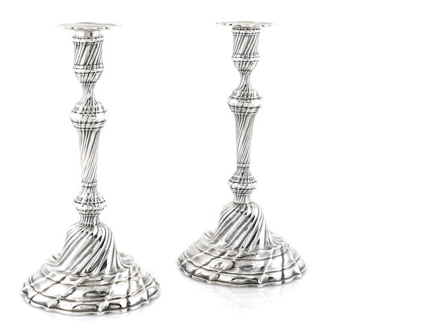 A pair of French silver candlesticks, bearing marks for Paris, 1819 - 1838