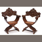 A pair of Italian Renaissance style carved walnut Savanarola chairs
