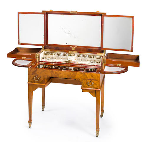 A George V Ceylon satinwood enclosed dressing table<BR />the silver fittings by Mappin & Webb, London 1921-22<BR />the cabinet by George Betjeman & Sons<BR />second quarter 20th century