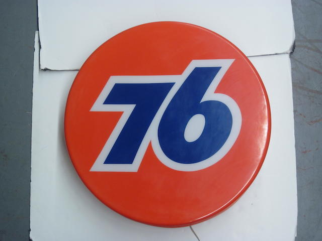 An illuminated 76 service station sign,