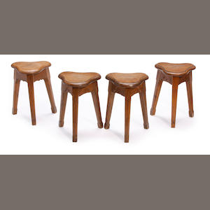 A set of four Arts and Craft style oak stools