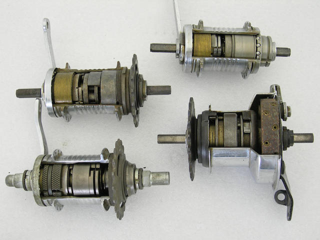 A group of four cut away Sturmey Archer multi speed hubs.