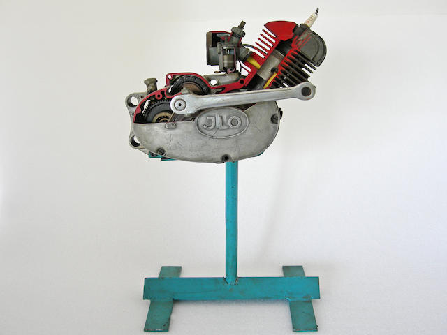 A cut away JLO moped engine with stand.